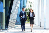 Business walking and talking in the street — Foto Stock
