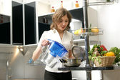 Young, attractive lady in luxury kitchen interior — Stock Photo