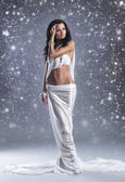 Fashion shoot of Aphrodite styled young woman over winter backgr — Stock Photo