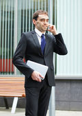 Young and smart business man talking on the phone — Stock Photo