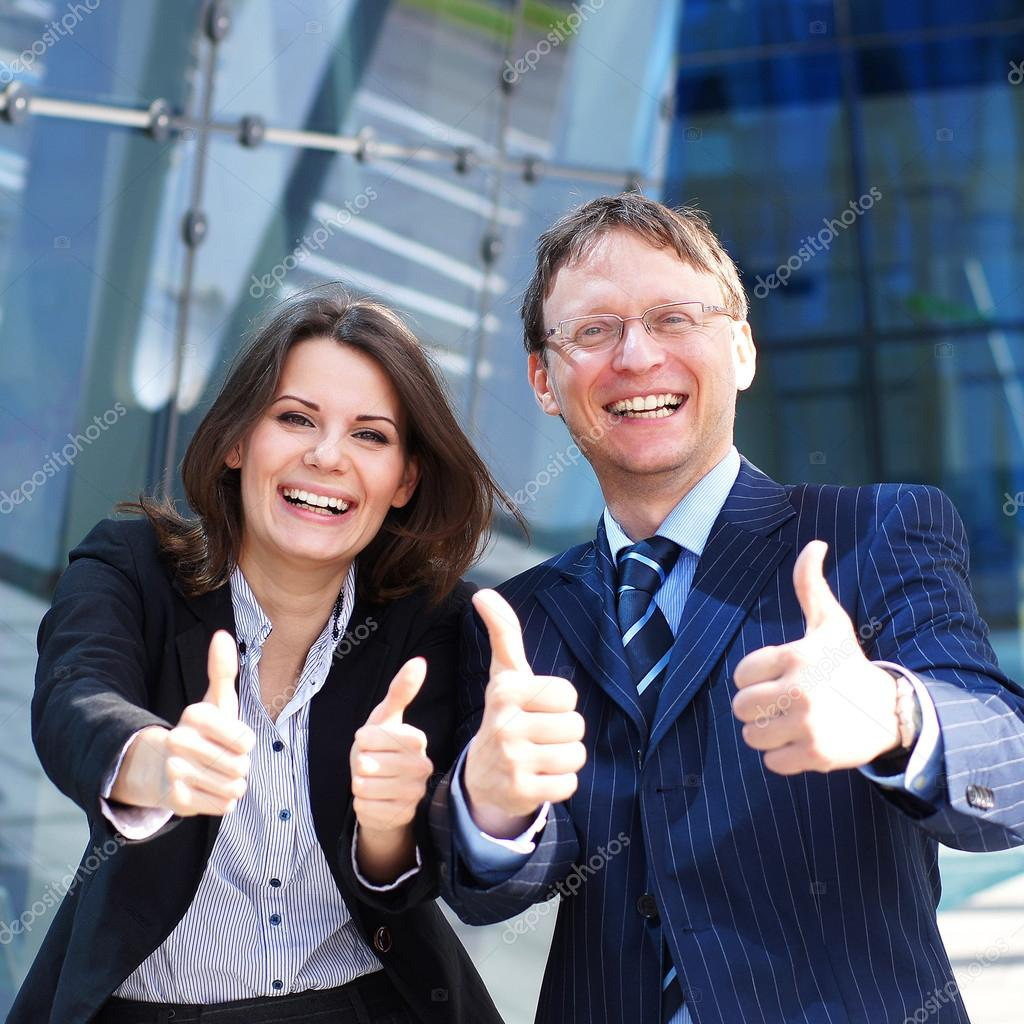 Successful business man and business woman standing over the modern background — Stock Photo #15382485