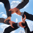 Stockfoto: Business concept of some hands over sky background