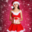 Young sexy Santa over Christmas background — Stock Photo #15390421