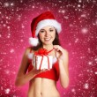 Royalty-Free Stock Photo: Young sexy Santa over Christmas background