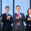 Business team over modern background — Stock Photo