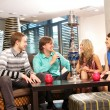 Stock Photo: Group of young and sexy smoking hookah in lounge caffee