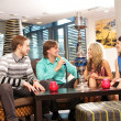 Group of young and sexy smoking hookah in the lounge caffee - Stock Photo
