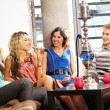 Group of young and sexy smoking hookah in the lounge caffee — 图库照片
