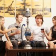 Group of young and sexy smoking hookah in the lounge caffee — Stockfoto