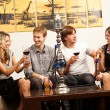 Group of young and sexy smoking hookah in the lounge caffee — Photo