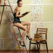 Fashion photo of young sexy woman reading book - Stock Photo