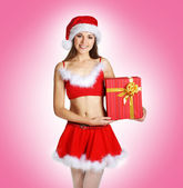 Sexy Santa over pink background — Stock Photo