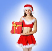 Sexy Santa over blue background — Stock Photo