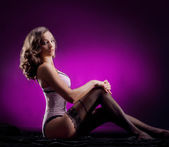 Fashion shoot of young attractive woman in vintage lingerie — Stock Photo