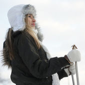 Woman with ski over winter background — Stock Photo