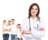 Young attractive family doctor isolated over white background — Stok fotoğraf