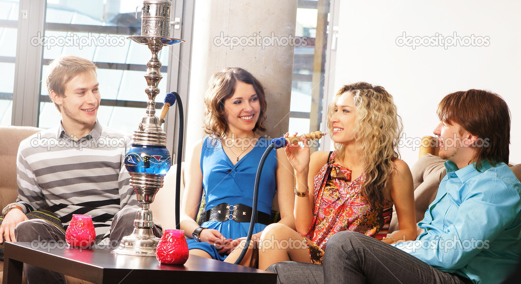 Group of young and sexy smoking hookah in the lounge caffee  Stock Photo #15393569