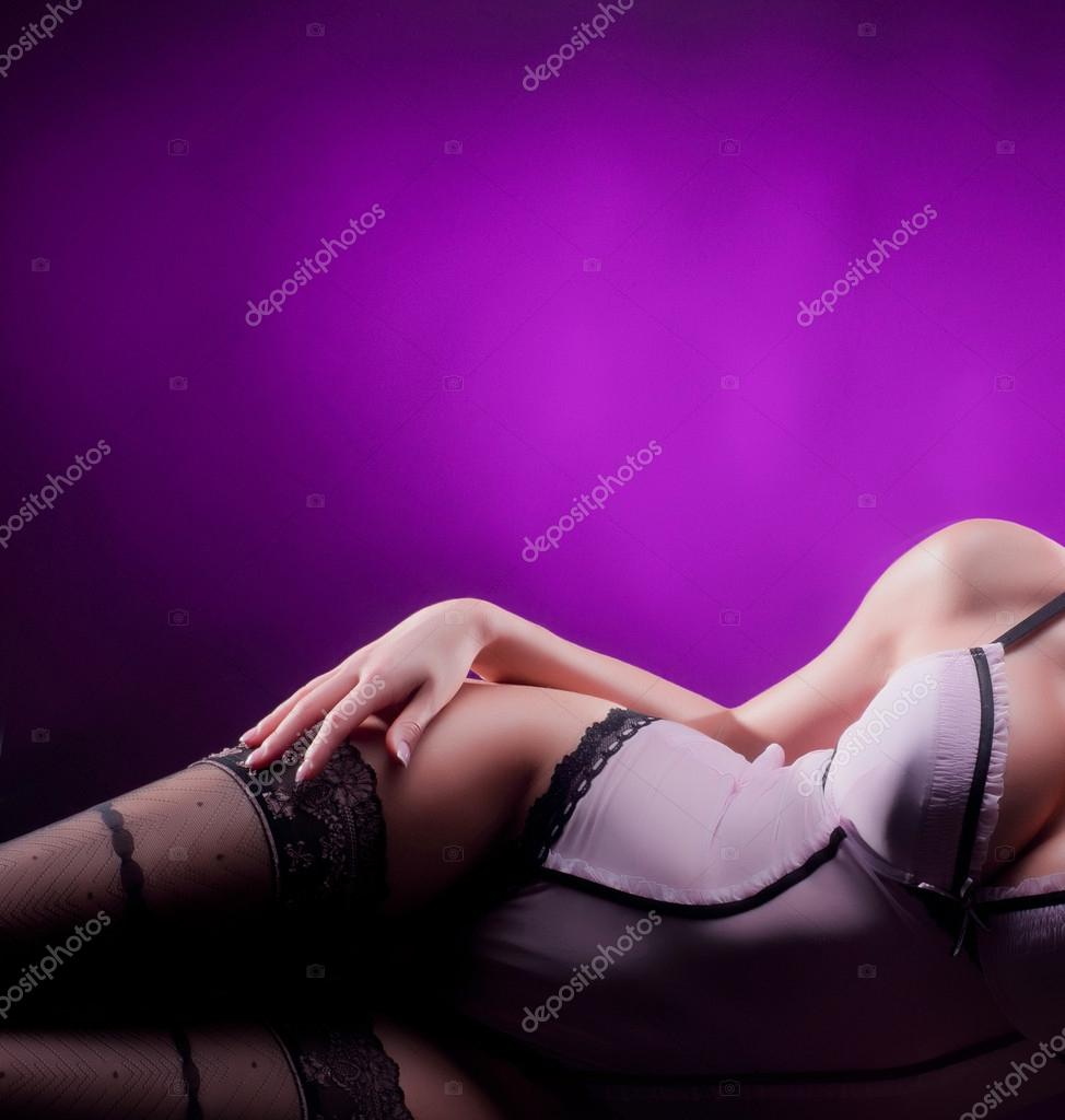 Young sexy woman in vintage lingerie laying in the bed — Stock Photo #15396233