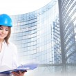 Young attractive female engineer over modern building — Stock Photo
