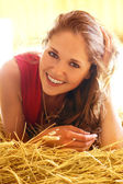 Young and beautiful woman in country style — Stock Photo