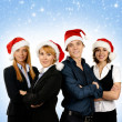 Stock Photo: Young attractive business in Christmas style over blue background