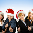 Young attractive business in Christmas style over blue background — Stock fotografie