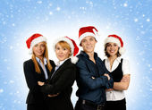 Young attractive business in Christmas style over blue background — Stock Photo