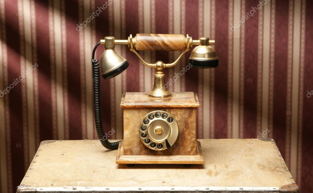 Vintage telephone over retro background — Zdjęcie stockowe #15437453
