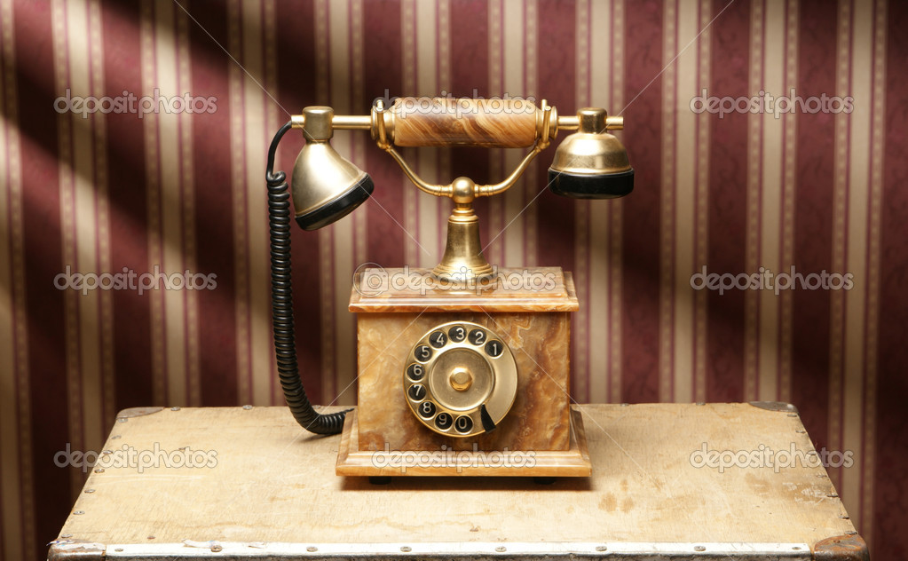Vintage telephone over retro background   #15437453