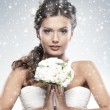 Young attractive bride with the bouquet of white roses — Stok fotoğraf