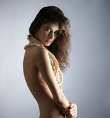 Young naked woman over grey background — Stock Photo