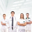 Team of young and smart medical workers — Stock Photo #15517331