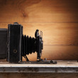 Ancient photo camera — Stockfoto