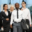 International business team over modern urban background — Stock Photo #15519609