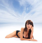 Young brunette in sexy lingerieover abstract resort backgound — Stock Photo