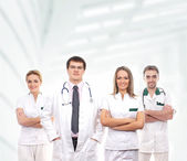 Team of young and smart medical workers — Photo