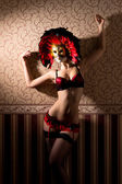 Sexy woman in nice lingerie in venetian mask — Stock Photo