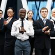 International business team over modern background — Stockfoto