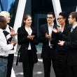 Stockfoto: International business team over modern background