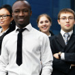 International business team over modern background - Stock Photo