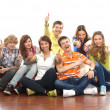 Teenagers sitting on the floor — Stock Photo #15521847