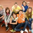 Stock Photo: Teenagers sitting on the floor