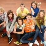 Teenagers sitting on the floor — Stock Photo