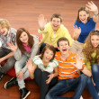 Teenagers sitting on the floor — Stock Photo #15521941