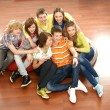 Teenagers watching television on the floor — Stock Photo #15522031