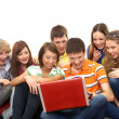 Teenagers with a notebook — Stock Photo