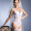 Young sexy bride in erotic lingerie over blue — Stock Photo #15525917