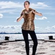 Royalty-Free Stock Photo: Fashion shoot of young attractive woman in fur dress