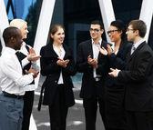 International business team over modern background — Stock Photo
