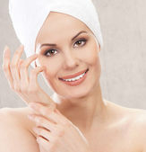 Spa portrait of young attractive woman in towel — Stock Photo